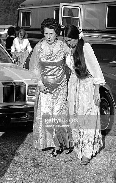 June Carter Cash walks Sara Carter at the AP Carter Memorial Festival in Maces Springs Virginia AP Carter was the leader of the Carter Family whose...
