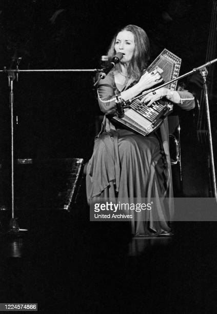 June Carter Cash wife of American country singer and song writer Johnny Cash playing a lyra while performing at Hamburg Germany circa 1981