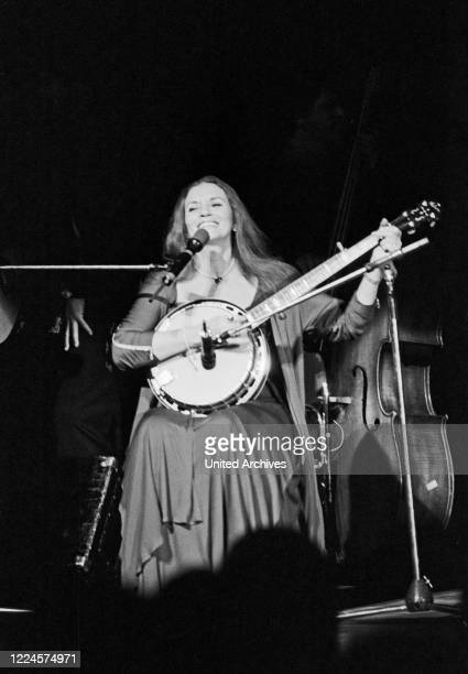 June Carter Cash, wife of American country singer and song writer Johnny Cash, playing banjo while performing at Hamburg, Germany, circa 1981.