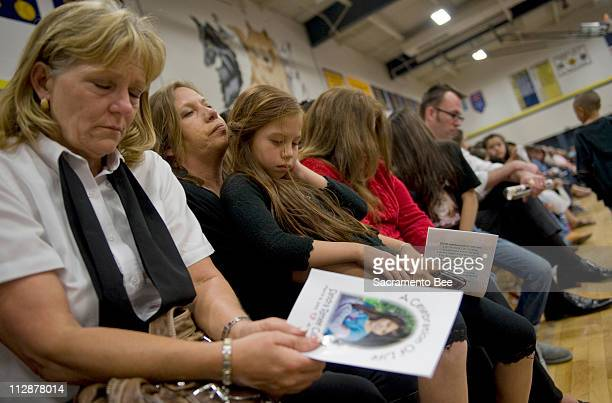 June Crawford, right, and Pam English with her daughter Kiana English take a moment to reflect during a memorial service for 8-year-old Sandra Cantu...