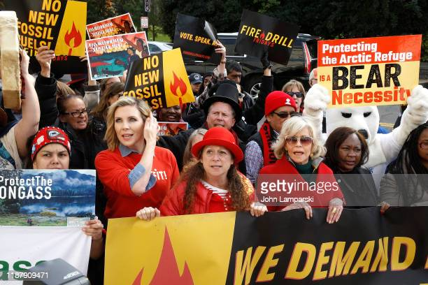 """June Diane Raphael, Abigail Disney and Jane Fonda demonstrate outside the Russell US Senate office building during """"Fire Drill Friday"""" climate change..."""