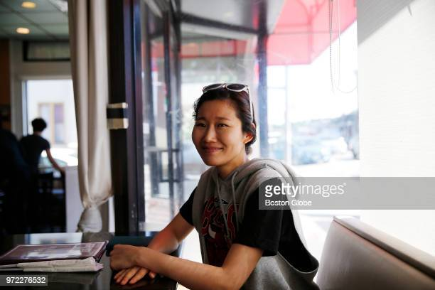 June Kim the assistant manager of Kaju Tofu House poses for a portrait in the Allston neighborhood of Boston on June 11 2018 She sees hope for...