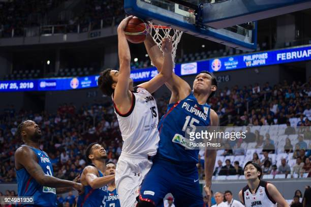 June Mar Fajardo of Gilas Pilipinas blocked the shot of J Takeuchi of Akatsuki Japan