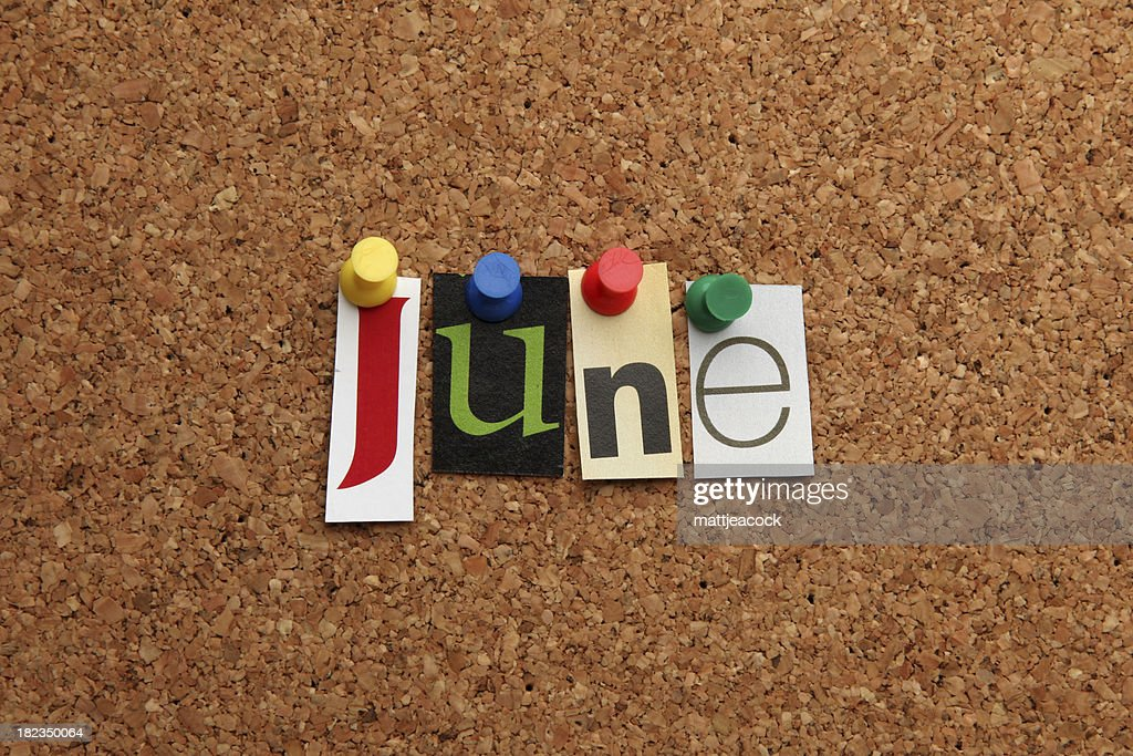 June pinned on noticeboard : Stock Photo