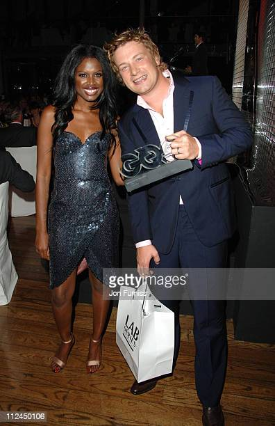 June Sarpong and Jamie Oliver during GQ Men of the Year Awards Drinks Reception at Royal Opera House in London Great Britain