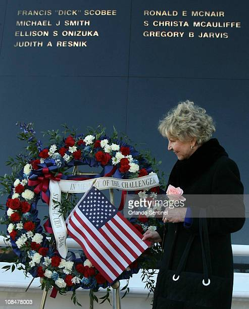 June Scobee Rodgers widow of Dick Scobee commander of space shuttle Challenger looks at a wreath Friday January 28 2011 that she placed in front of...