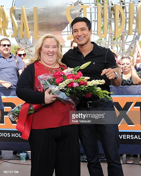 June Shannon and Mario Lopez visit 'Extra' at Universal Studios Hollywood on September 9 2013 in Universal City California