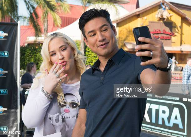 June Shannon takes a selfie with Mario Lopez at 'Extra' at Universal Studios Hollywood on January 11 2018 in Universal City California