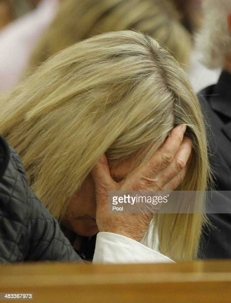 June Steenkamp hides her face as she listens to Oscar Pistorius' testimony in the Pretoria High Court on April 8 in Pretoria, South Africa. Oscar...