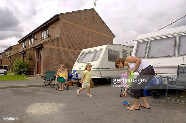 June Willey left watches Nicola Caster right as she plays with her daughter Holly outside their caravan on California Drive in Catcliffe Sheffield UK...
