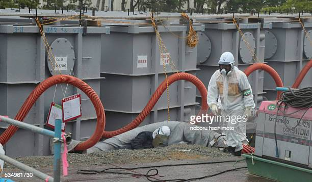 June122013/Noboru Hashimoto/FukushimaJapan Tokyo Electric power plant workers makes constract water tanks and works reliability improvement of...