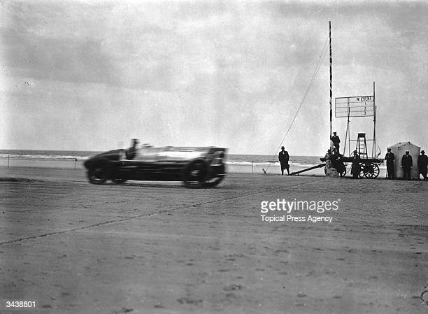 Captain Malcolm Campbell at a speed of 130 mph in his Sunbeam racing car during speed trials on the beach at Saltburn