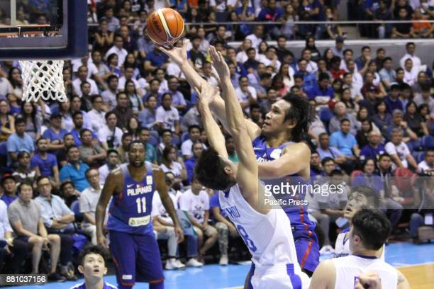 Junemar Fajardo of the Philippines laysup the ball over PoChen Chou of Chinese Taipei to convert an uncontested layup during their FIBA World Cup...