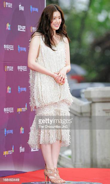 Jung Eun-Chae poses for photographs upon arrival during 49th Paeksang Arts Awards at Grand Peace Palace in Kyung Hee University on May 9, 2013 in...