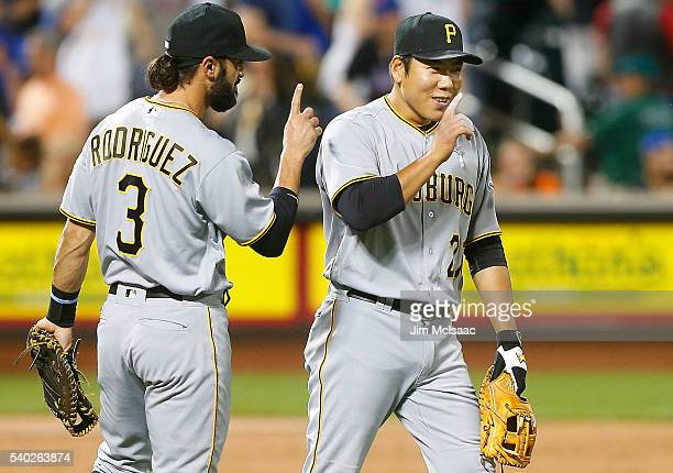 Jung Ho Kang and Sean Rodriguez of the Pittsburgh Pirates celebrate after defeating the New York Mets at Citi Field on June 14 2016 in the Flushing...