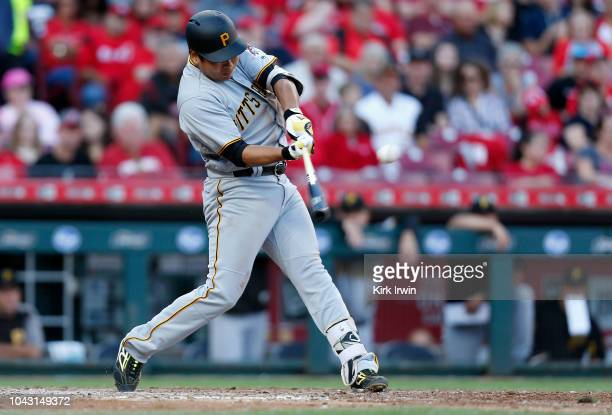 Jung Ho Kang hits a single during the sixth inning of the game against the Cincinnati Reds at Great American Ball Park on September 29 2018 in...