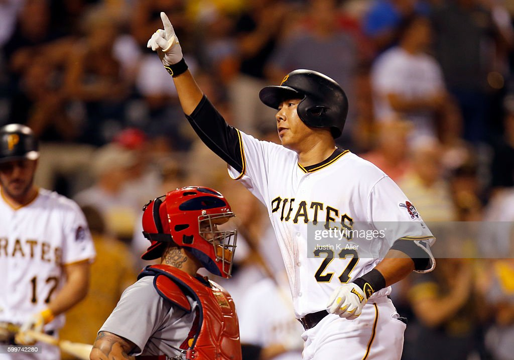 Jung Ho Kang #27 of the Pittsburgh Pirates celebrates after hitting a solo home run in the fourth inning during the game against the St. Louis Cardinals at PNC Park on September 6, 2016 in Pittsburgh, Pennsylvania.