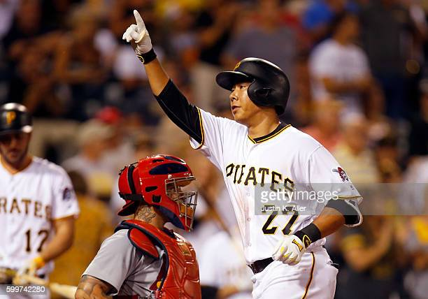 Jung Ho Kang of the Pittsburgh Pirates celebrates after hitting a solo home run in the fourth inning during the game against the St Louis Cardinals...