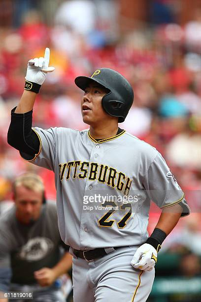 Jung Ho Kang of the Pittsburgh Pirates celebrates after hitting a threerun home against the St Louis Cardinals in the first inning at Busch Stadium...