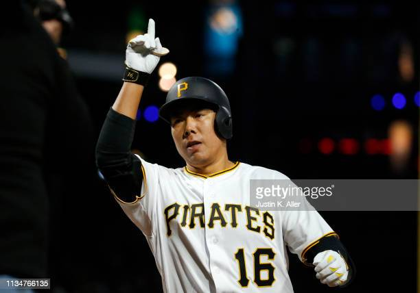 Jung Ho Kang of the Pittsburgh Pirates celebrates his solo home run in the third inning against the St Louis Cardinals at PNC Park on April 3 2019 in...