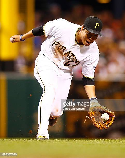 Jung Ho Kang of the Pittsburgh Pirates fields a ground ball at third base against the Cincinnati Reds during the game at PNC Park on June 24 2015 in...