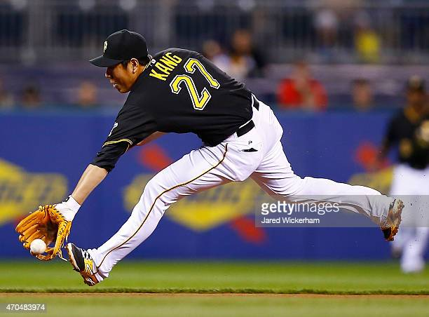 Jung Ho Kang of the Pittsburgh Pirates fields a ground ball in the fifth inning against the Chicago Cubs during the game at PNC Park on April 20 2015...