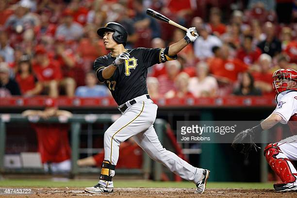 Jung Ho Kang of the Pittsburgh Pirates follows through on a grand slam home run in the sixth inning against the Cincinnati Reds at Great American...