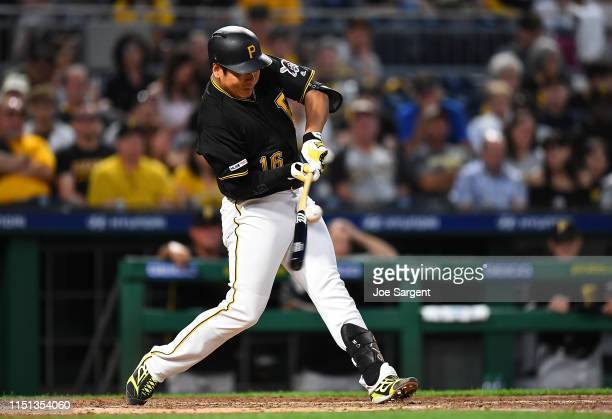 Jung Ho Kang of the Pittsburgh Pirates hits a double during the seventh inning against the San Diego Padres at PNC Park on June 21 2019 in Pittsburgh...