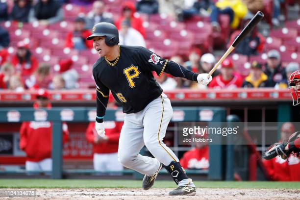 Jung Ho Kang of the Pittsburgh Pirates hits a double to left field in the ninth inning against the Cincinnati Reds at Great American Ball Park on...