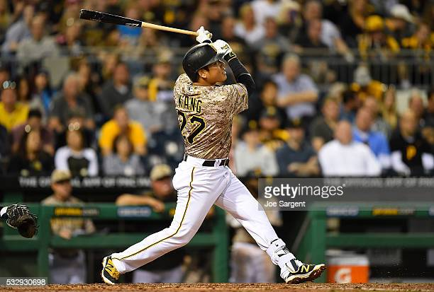 Jung Ho Kang of the Pittsburgh Pirates hits a RBI sacrifice fly during the fifth inning against the Atlanta Braves on May 19 2016 at PNC Park in...