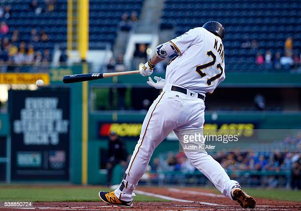 Jung Ho Kang of the Pittsburgh Pirates hits a RBI single in the first inning during the game against the New York Mets at PNC Park on June 8 2016 in...