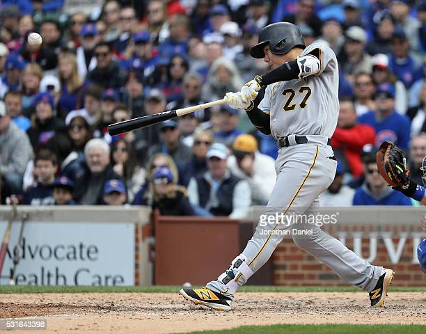 Jung Ho Kang of the Pittsburgh Pirates hits a solo home run in the 9th inning against thre Chicago Cubs at Wrigley Field on May 15 2016 in Chicago...