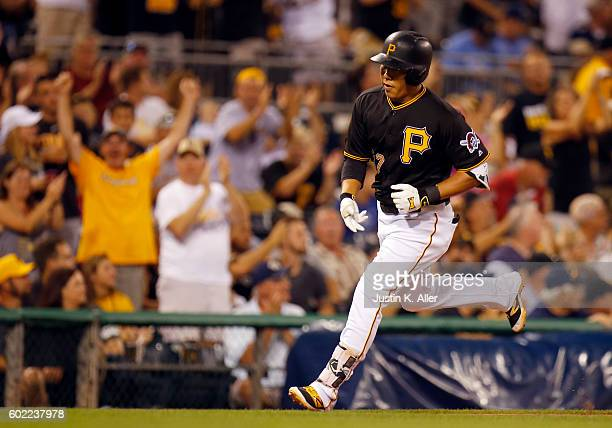 Jung Ho Kang of the Pittsburgh Pirates hits a two run home run in the second inning during the game against the Cincinnati Reds at PNC Park on...
