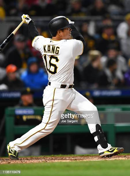 Jung Ho Kang of the Pittsburgh Pirates hits an RBI double during the seventh inning against the Cincinnati Reds at PNC Park on April 5 2019 in...