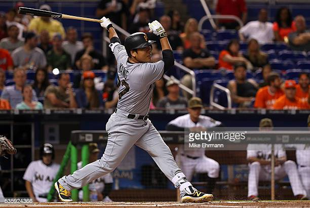 Jung Ho Kang of the Pittsburgh Pirates hits an RBI single during a game against the Miami Marlins at Marlins Park on May 30 2016 in Miami Florida