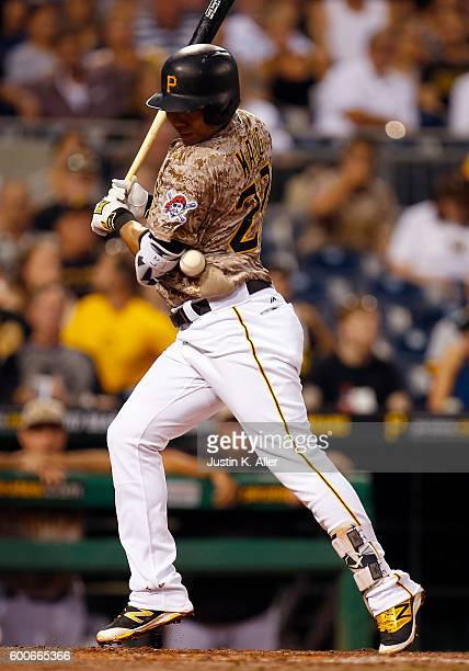 Jung Ho Kang of the Pittsburgh Pirates is hit by a pitch in the third inning during the game against the Cincinnati Reds at PNC Park on September 8...