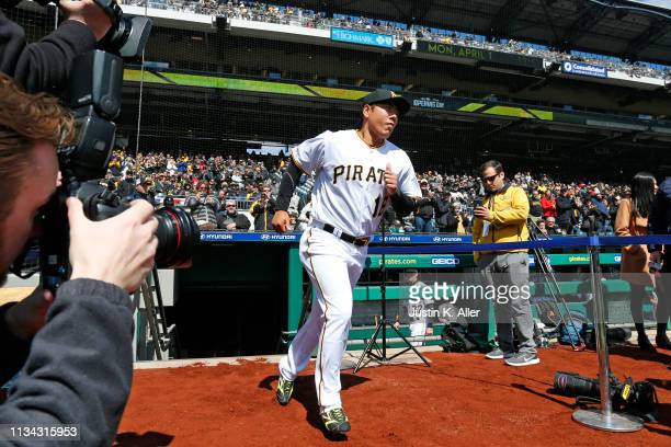 Jung Ho Kang of the Pittsburgh Pirates is introduced before the game against the St. Louis Cardinals at the home opener at PNC Park on April 1, 2019...