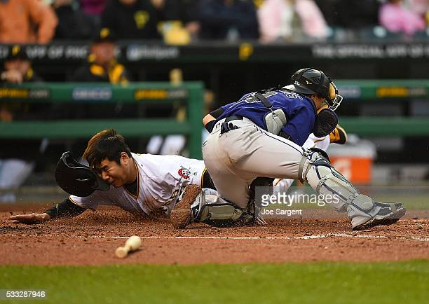Jung Ho Kang of the Pittsburgh Pirates is tagged out at home plate by Tony Wolters of the Colorado Rockies during the fourth inning on May 21 2016 at...