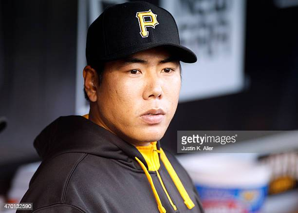 Jung Ho Kang of the Pittsburgh Pirates looks on from the dugout during the game against the Milwaukee Brewers at PNC Park on April 17 2015 in...