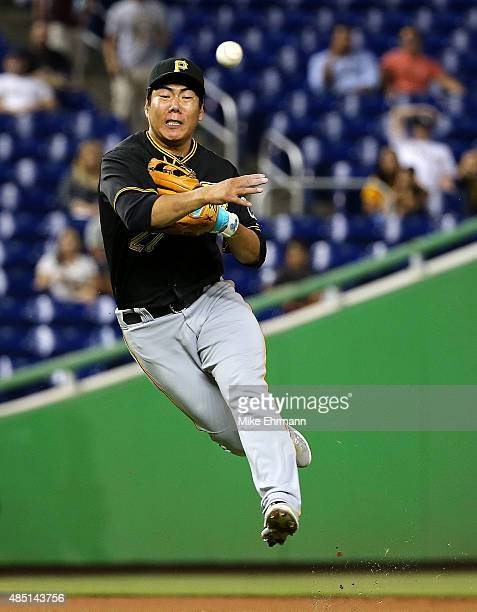 Jung Ho Kang of the Pittsburgh Pirates makes a throw to first during a game against the Miami Marlins at Marlins Park on August 24 2015 in Miami...