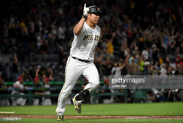 Jung Ho Kang of the Pittsburgh Pirates reacts as he rounds the bases after hitting a home run in the ninth inning during the game against the...