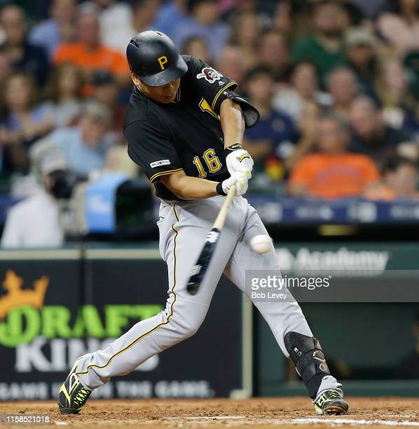 Jung Ho Kang of the Pittsburgh Pirates singles in a run in the third inning against the Houston Astros at Minute Maid Park on June 26 2019 in Houston...
