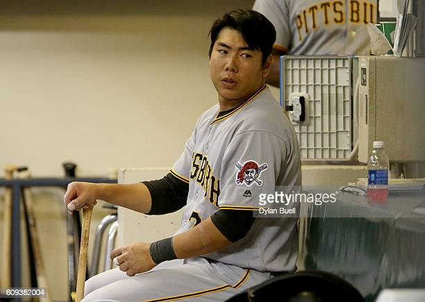 Jung Ho Kang of the Pittsburgh Pirates sits in the dugout in the sixth inning against the Milwaukee Brewers at Miller Park on September 20 2016 in...