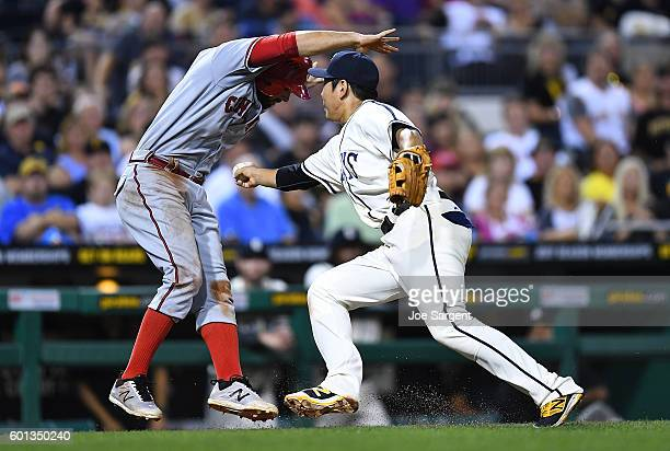 Jung Ho Kang of the Pittsburgh Pirates tags out Jose Peraza of the Cincinnati Reds after getting caught in a rundown during the seventh inning on...