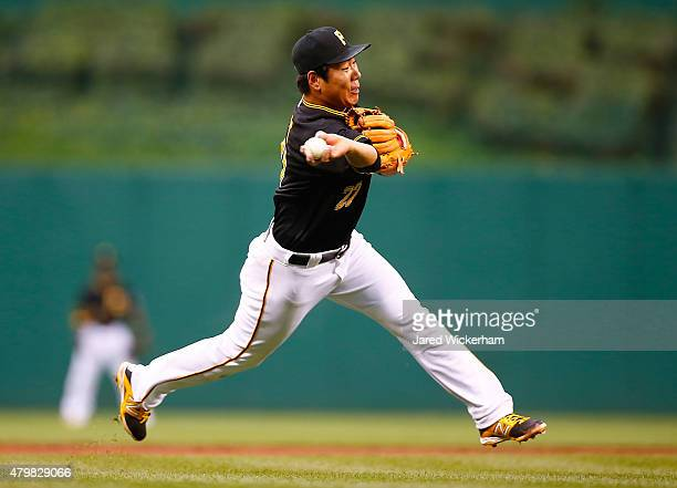 Jung Ho Kang of the Pittsburgh Pirates throws to first base in the second inning against the San Diego Padres during the game at PNC Park on July 7...