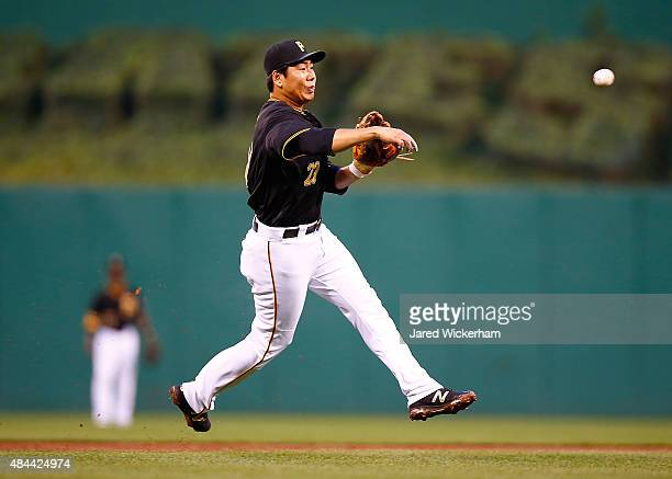 Jung Ho Kang of the Pittsburgh Pirates throws to first base in the second inning against the Arizona Diamondbacks during the game at PNC Park on...
