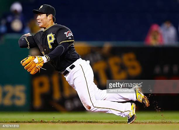Jung Ho Kang of the Pittsburgh Pirates throws to third base in the eighth inning against the Chicago Cubs during the game at PNC Park on April 22...