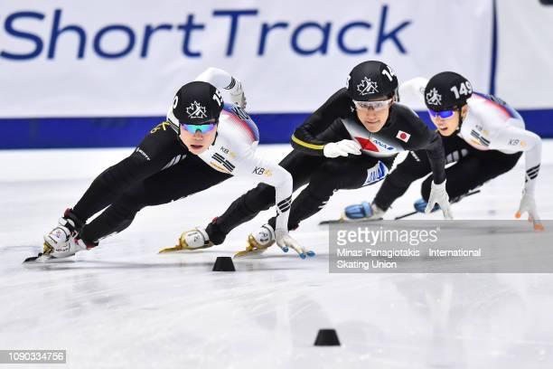 Jung Ho Kyoung of Korea skates ahead of Kazuki Yoshinaga of Japan and Chang Hyun Woo of Korea in the men's 1000m semifinal during the ISU World...
