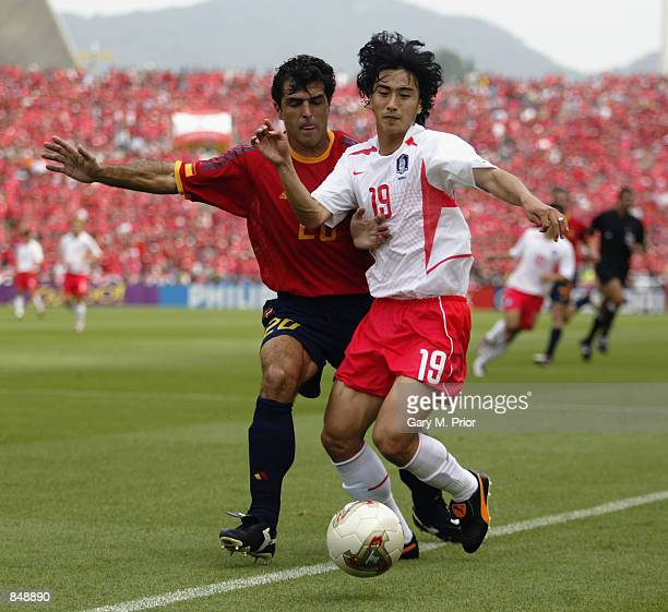 Jung Hwan Ahn of South Korea fends off the challenge of Nadal of Spain during the FIFA World Cup Finals 2002 Quarter Finals match played at the...