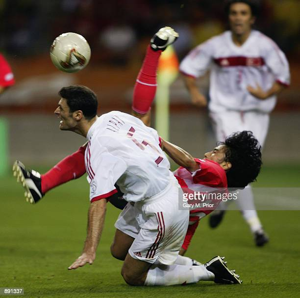 Jung Hwan Ahn of South Korea loses out to Alpay Ozalan of Turkey during the FIFA World Cup Finals 2002 Third Place PlayOff match played at the Daegu...
